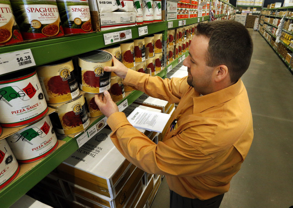"Store manager Brad Beers shows the ""small"" size spaghetti sauce Tuesday at the new Chef'store in Oklahoma City. Photo by Steve Sisney, The Oklahoman"