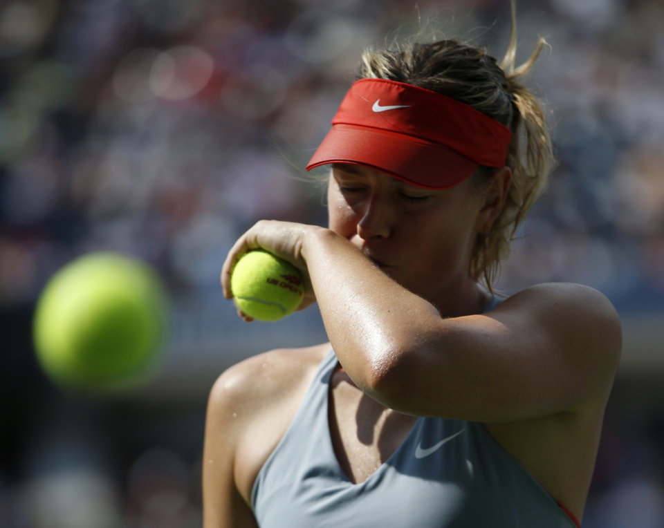 Photo - Maria Sharapova, of Russia, prepares to serve against Caroline Wozniacki, of Denmark, during the fourth round of the 2014 U.S. Open tennis tournament, Sunday, Aug. 31, 2014, in New York. (AP Photo/Kathy Willens)