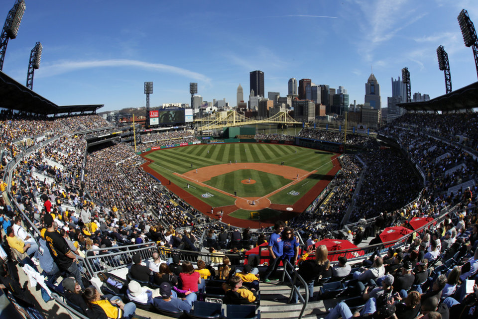 Photo - In this photo taken with a fisheye lens, baseball fans at in PNC Park watch the season opening baseball game between the Pittsburgh Pirates and the Chicago Cubs in Pittsburgh, Monday, March 31, 2014. The Pirates won 1-0 in ten innings.(AP Photo/Gene J. Puskar)