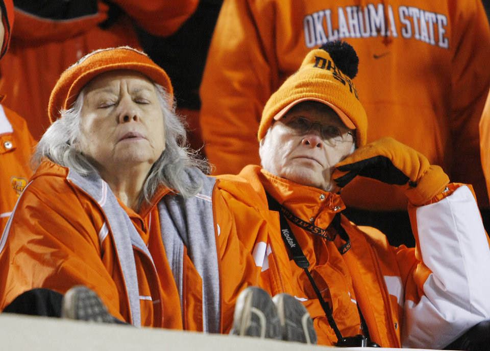 Oklahoma State fans react to the 61-41 loss to Oklahoma during the second half of the college football game between the University of Oklahoma Sooners (OU) and Oklahoma State University Cowboys (OSU) at Boone Pickens Stadium on Saturday, Nov. 29, 2008, in Stillwater, Okla. STAFF PHOTO BY CHRIS LANDSBERGER