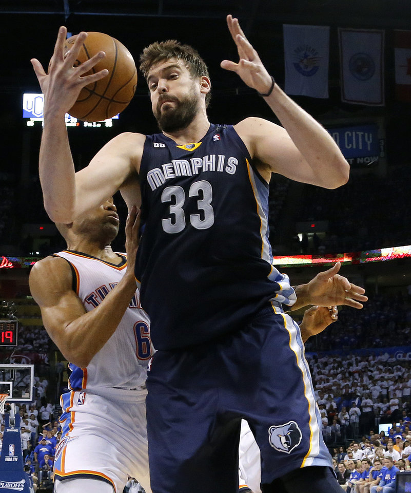 Photo - Memphis' Marc Gasol (33) goes past Oklahoma City's Derek Fisher (6) during Game 2 in the second round of the NBA playoffs between the Oklahoma City Thunder and the Memphis Grizzlies at Chesapeake Energy Arena in Oklahoma City, Tuesday, May 7, 2013. Oklahoma  City lost 99-93. Photo by Bryan Terry, The Oklahoman