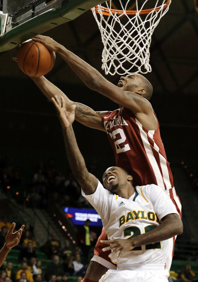 Photo - Oklahoma's Amath M'Baye (22) blocks a lay-up by Baylor 's A.J. Walton (22) during the second half of an NCAA college basketball game Wednesday, Jan. 30, 2013, in Waco, Texas. Oklahoma won 74-71. (AP Photo/Tony Gutierrez) ORG XMIT: TXTG110