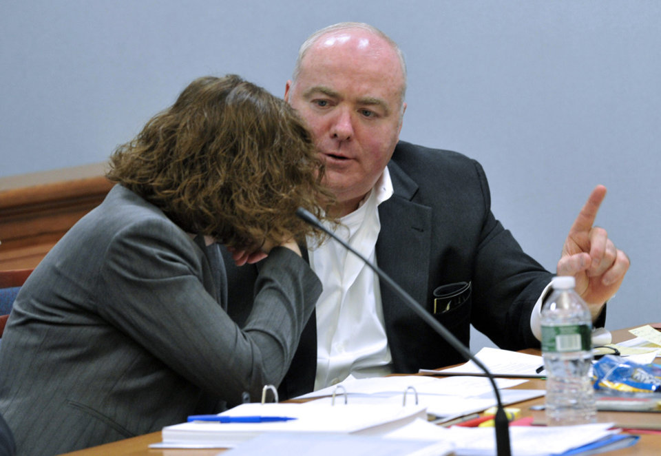Photo - Michael Skakel, right, talks with one of his defense attorneys, Jessica Santos, at Skakel's habeas corpus trial at State Superior Court in Vernon, Conn., on Wednesday, April 24, 2013.   Skakel, who did not testify at his trial but did speak at last year when he was denied parole, began testifying Wednesday. (AP Photo/The Stamford Advocate,Jason Rearick, Pool )