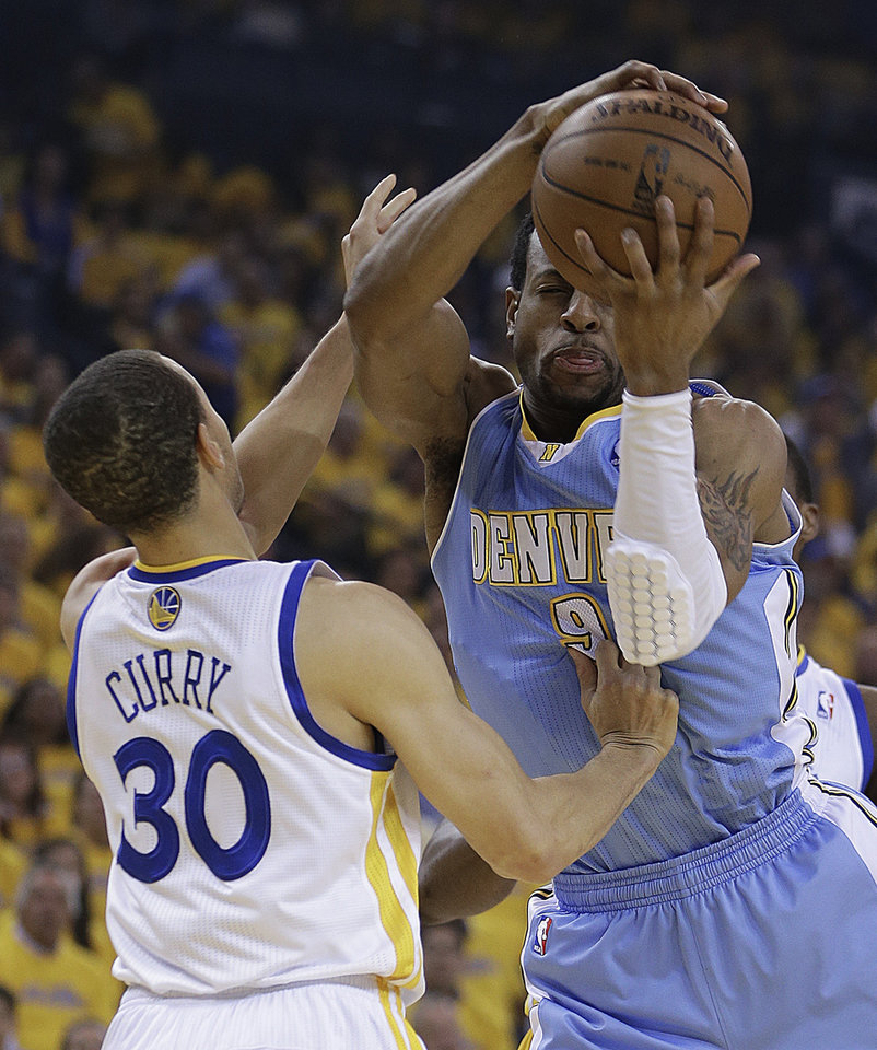 Golden State Warriors' Stephen Curry (30) guards Denver Nuggets' Andre Iguodala, right, during the first half of Game 3 in a first-round NBA basketball playoff series on Friday, April 26, 2013, in Oakland, Calif. (AP Photo/Ben Margot)