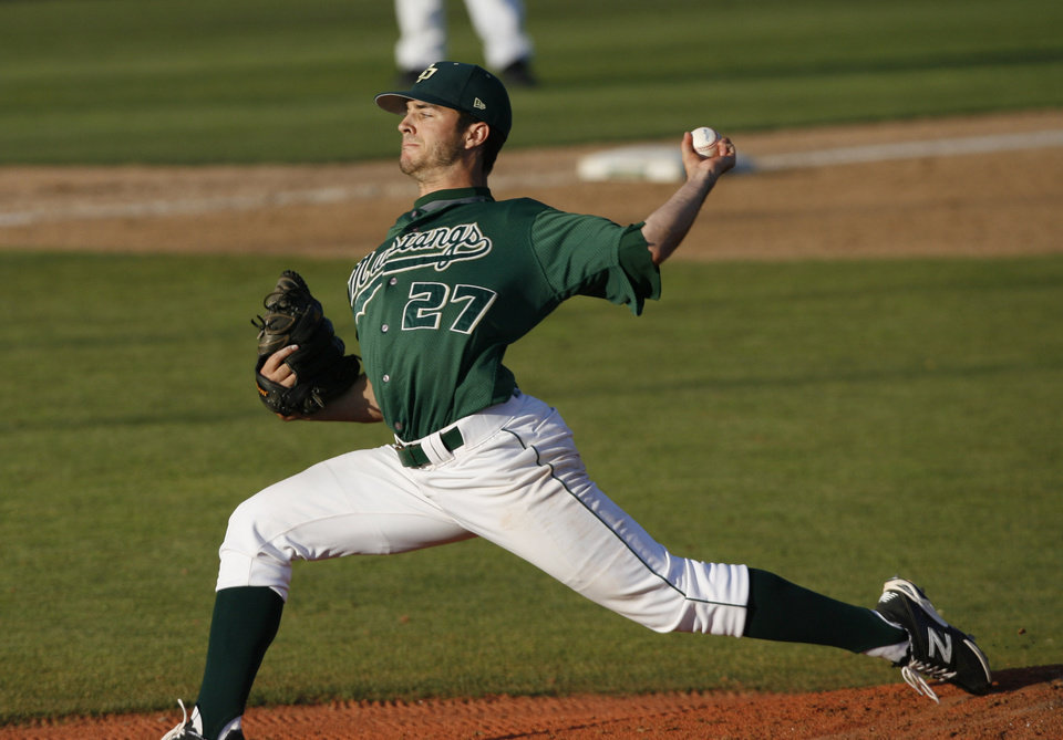 Photo - Cal Poly pitcher Taylor Chris delivers a pitch during the third inning of an NCAA college baseball tournament regional game against Pepperdine on Sunday, June 1, 2014, at Baggett Stadium at Cal Poly in San Luis Obispo, Calif. (AP Photo/Aaron Lambert)