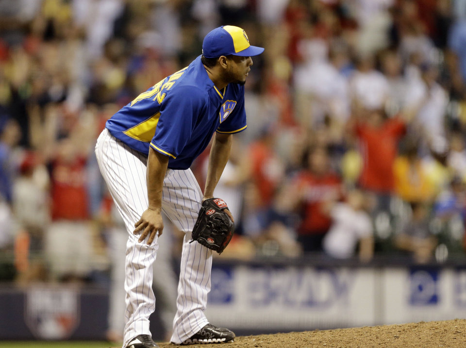 Photo - Milwaukee Brewers' Francisco Rodriguez watches the home run by St. Louis Cardinals' Matt Holliday during the ninth inning of a baseball game Friday, July 11, 2014, in Milwaukee. (AP Photo/Jeffrey Phelps)