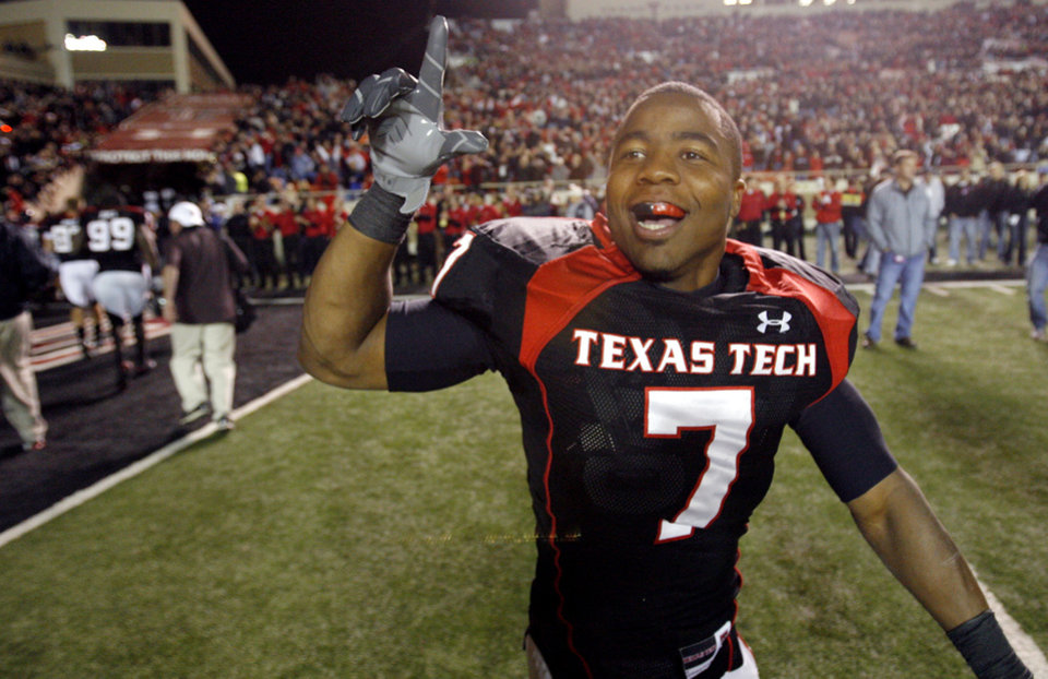 Texas Tech's Darcel McBath (7) celebrates after the 56-20 win over Oklahoma State during the college football game between the Oklahoma State University Cowboys (OSU) and the Texas Tech Red Raiders at Jones AT&T Stadium on Saturday, Nov. 8, 2008, in Lubbock, Tex.