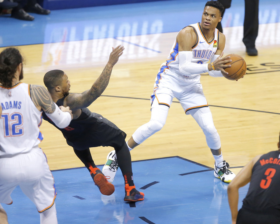 Photo - Oklahoma City's Russell Westbrook (0) gets called for a foul as he runs into Portland's Damian Lillard during Game 4 in the first round of the NBA playoffs between the Portland Trail Blazers and the Oklahoma City Thunder at Chesapeake Energy Arena in Oklahoma City, Sunday, April 21, 2019. Photo by Bryan Terry, The Oklahoman