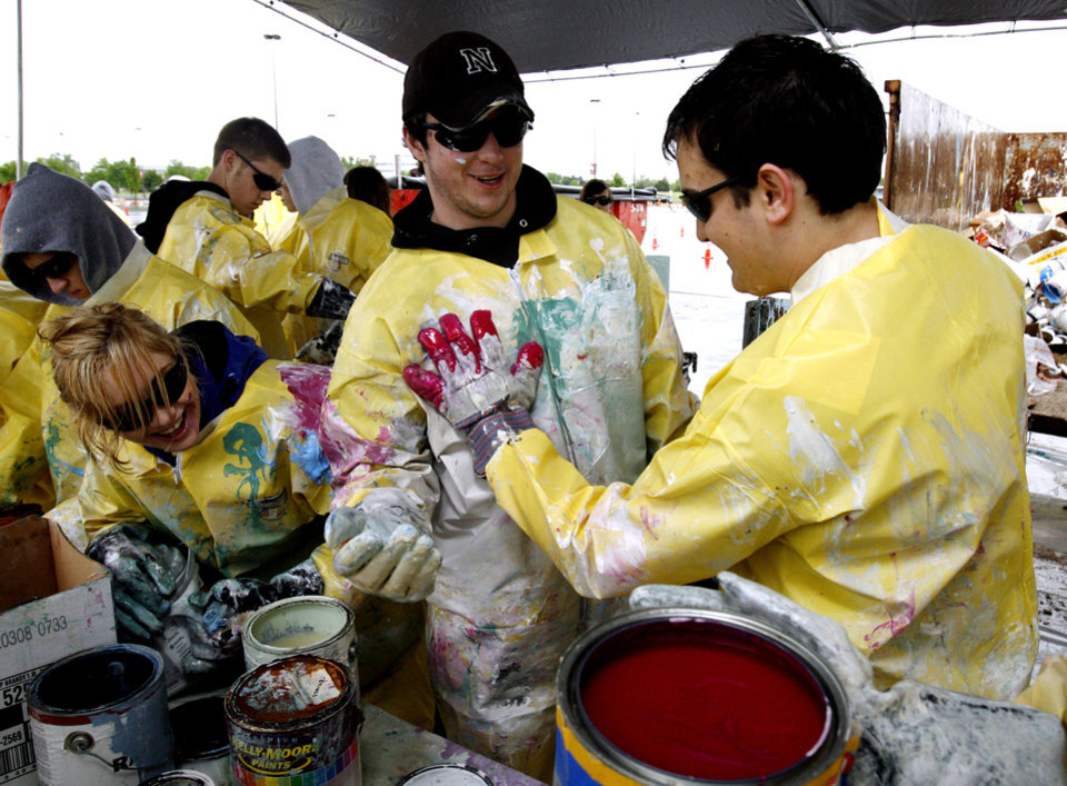 Photo - Sarah Collvins watches as Alec Wilkinson gets a paint sample from Blake Smith as Norman High School Students volunteer at the annual hazardous waste disposal at Lloyd Noble Center in Norman, Okla. on May 2, 2009.  Photo by Steve Sisney, The Oklahoman