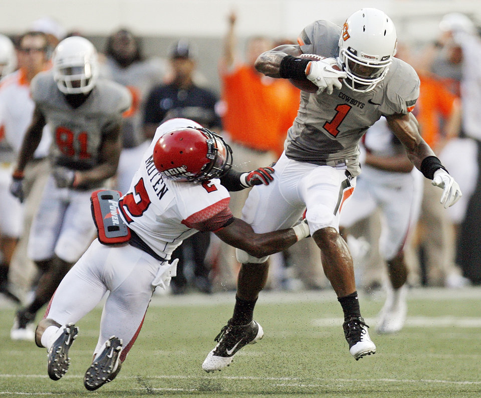 OSU\'s Joseph Randle tries to break away from Jemarious Moten of ULL in the second quarter on Saturday. Photo by Nate Billings, The Oklahoman