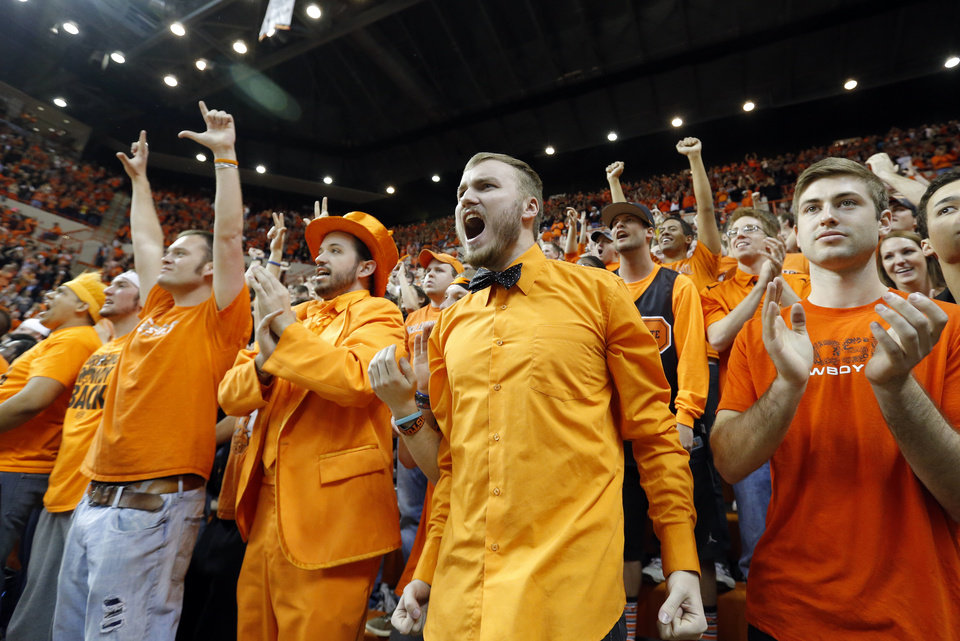 Photo - Fans celebrate during the final seconds of the Bedlam men's college basketball game between the Oklahoma State University Cowboys and the University of Oklahoma Sooners at Gallagher-Iba Arena in Stillwater, Okla., Saturday, Feb. 16, 2013. Photo by Sarah Phipps, The Oklahoman