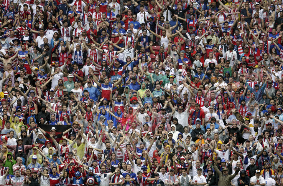 Photo - US fans cheer for their team during the group G World Cup soccer match between the USA and Germany at the Arena Pernambuco in Recife, Brazil, Thursday, June 26, 2014. (AP Photo/Petr David Josek)