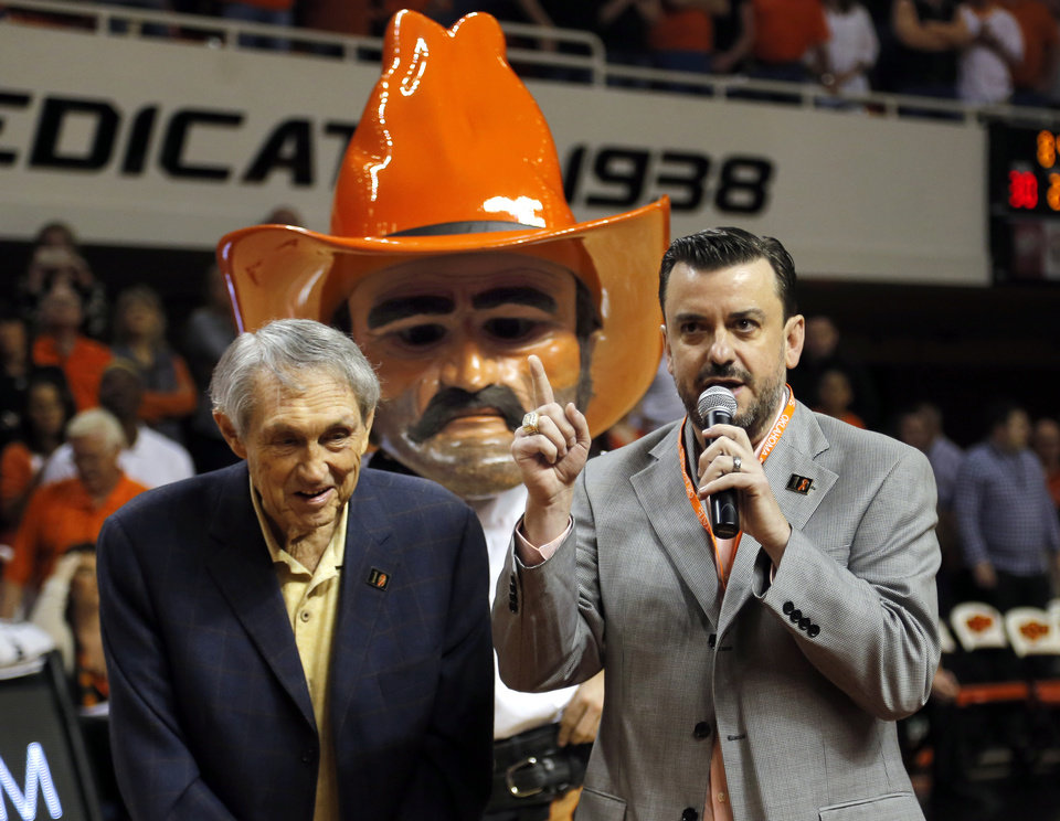 Photo - Larry Reece introduces Eddie Sutton at a half time ceremony during the men's college basketball game between Oklahoma State University and the University of Kansas at Gallagher-Iba Arena in Stillwater, Okla.,  Saturday, Feb. 7, 2015. OSU won 67-62. Photo by Sarah Phipps, The Oklahoman