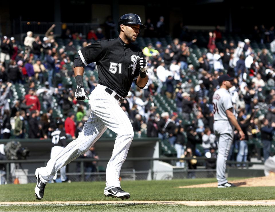 Photo - Chicago White Sox's Alex Rios heads to first after hitting a two-run home run off Cleveland Indians starting pitcher Zach McAllister, background right, during the fifth inning of a baseball game Wednesday, April 24, 2013, in Chicago. (AP Photo/Charles Rex Arbogast)