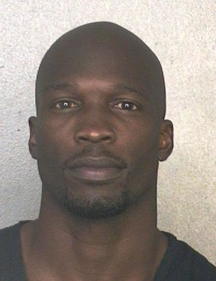 This arrest photo made available by the Broward County Sheriff's Office shows former NFL wide receiver Chad Johnson Monday, May 20, 2013. Johnson has been arrested on charges that he violated probation stemming from an altercation with his now ex-wife, TV reality star Evelyn Lozada. A Broward County judge ordered Johnson jailed Monday until he posts a $1,000 bond.  (AP Photo/Broward County Sheriff's Office)