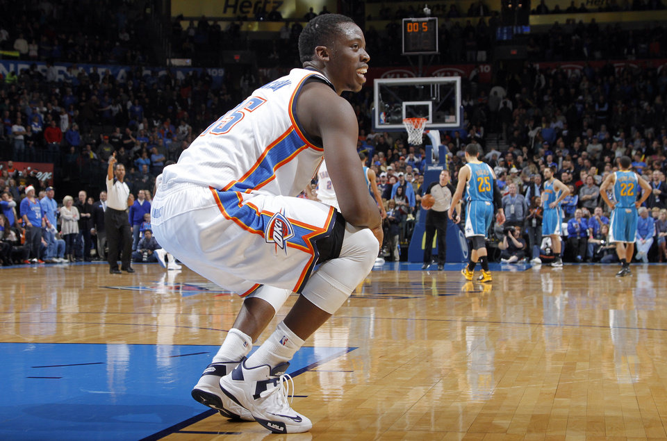 Photo - Oklahoma City Thunder's Reggie Jackson (15) reacts in the final seconds of the Thunder win over New Orleans during the NBA basketball game between the Oklahoma CIty Thunder and the New Orleans Hornets at the Chesapeake Energy Arena on Wednesday, Dec. 12, 2012, in Oklahoma City, Okla.   Photo by Chris Landsberger, The Oklahoman