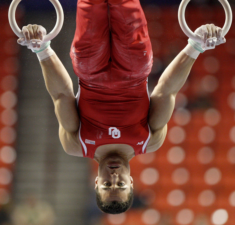 Photo - Oklahoma's Jake Dalton competes on the rings during the men's NCAA college gymnastics championships in at the Lloyd Noble Center in Norman, Okla., Thursday, April19, 2012. Photo by Bryan Terry, The Oklahoman