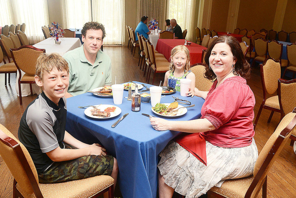 Photo - Sam (11), Scott, Annie (6), and Laurie Boeh. Photo by David Faytinger, for the Oklahoman.