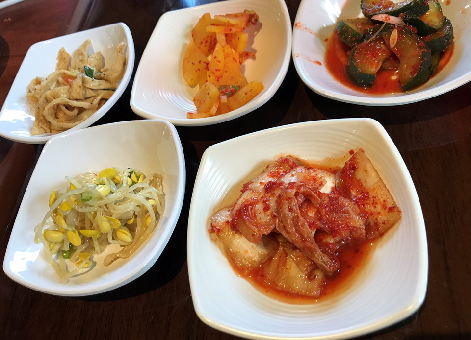 Photo - Banchan from Taste of Korea in Oklahoma City. [Dave Cathey/The Oklahoman]