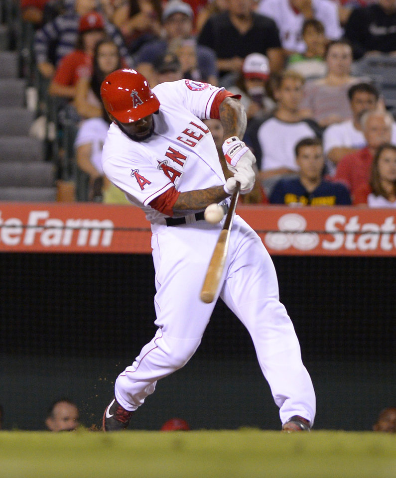 Photo - Los Angeles Angels' Howie Kendrick hits an RBI single during the sixth inning of a baseball game against the Philadelphia Phillies, Wednesday, Aug. 13, 2014, in Anaheim, Calif. (AP Photo/Mark J. Terrill)