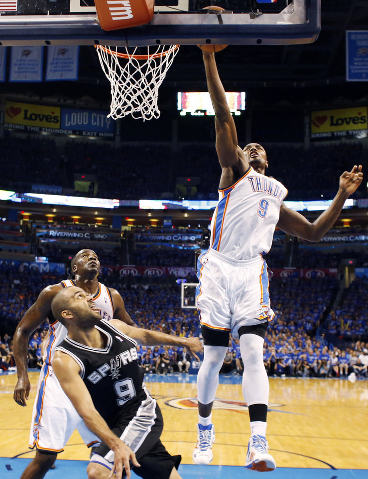 Photo - Oklahoma City's Serge Ibaka (9) blocks the shot of San Antonio's Tony Parker (9) during Game 3 of the Western Conference Finals in the NBA playoffs between the Oklahoma City Thunder and the San Antonio Spurs at Chesapeake Energy Arena in Oklahoma City, Sunday, May 25, 2014. Photo by Nate Billings, The Oklahoman
