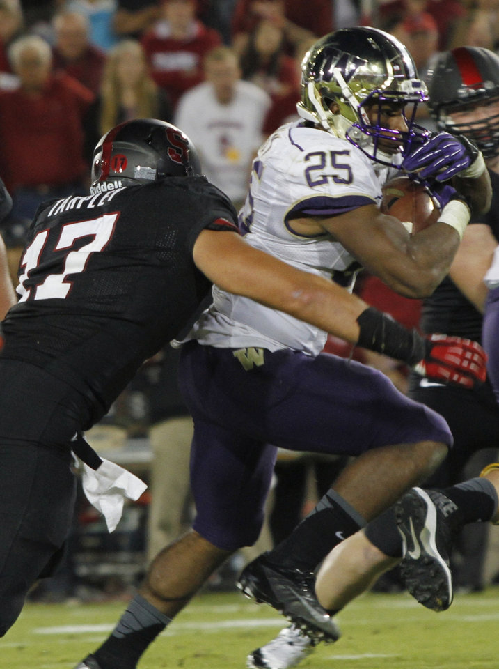 Photo - Washington's Bishop Sanket (25) runs for a touchdown as Stanford's A.J. Tarpley defends during the first half of an NCAA college football game in Stanford, Calif., Saturday, Oct. 5, 2013. (AP Photo/George Nikitin)