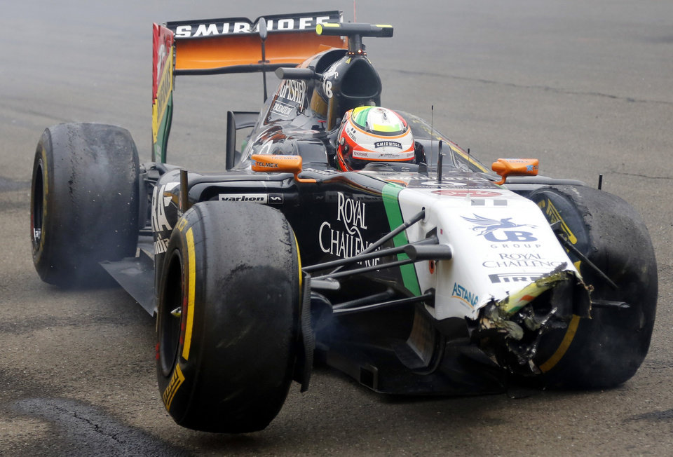 Photo - Force India driver Sergio Perez of Mexico sits in his wrecked carn during the Hungarian Formula One Grand Prix in Budapest, Hungary, Sunday, July 27, 2014. (AP Photo/Darko Bandic, pool)