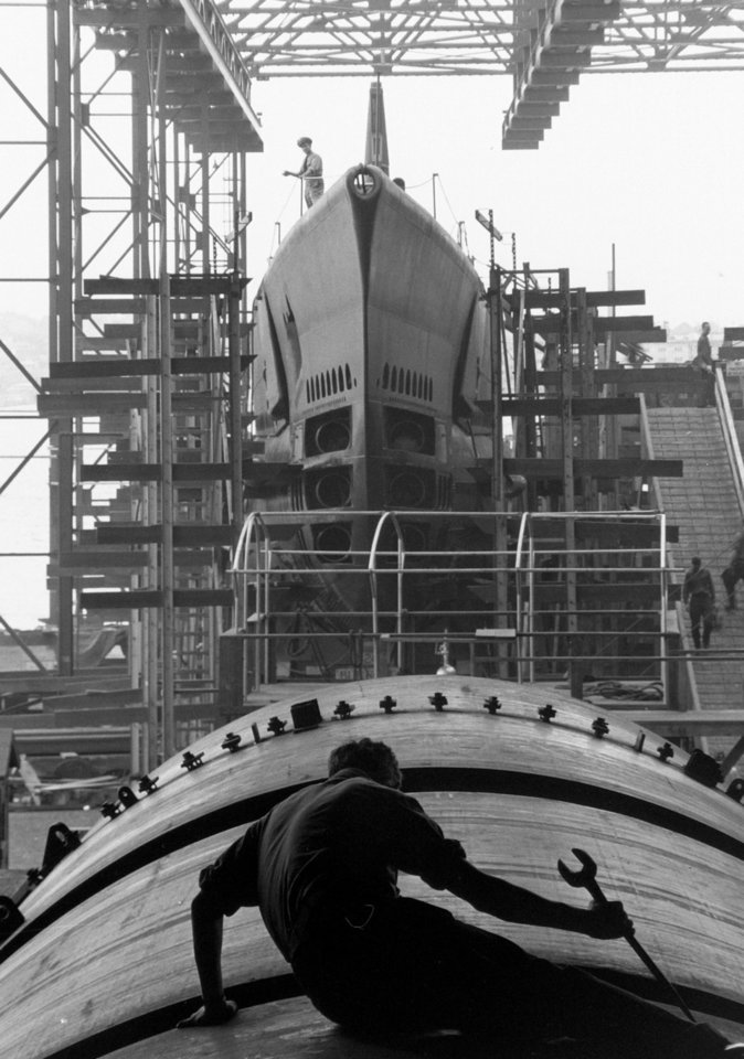 Photo - This August 1943 photo provided by  the National Archives, General Records of the U.S. Navy, shows a submarine builder at Electric Boat Company in Groton, Conn. The photo is part of