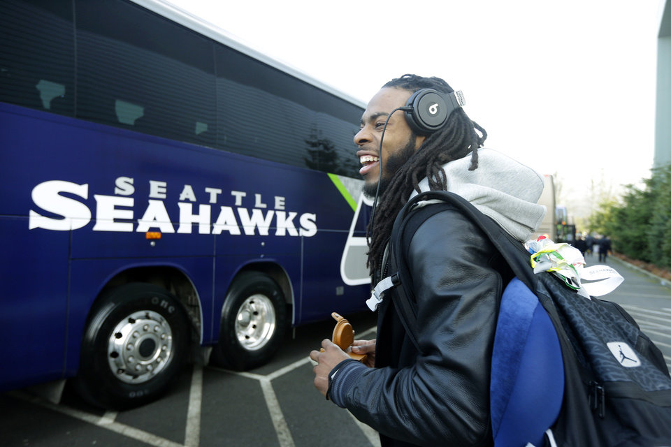 Photo - Seattle Seahawks cornerback Richard Sherman leaves team headquarters in Renton, Wash., Sunday, Jan. 26, 2014, to board a bus for his flight to play the Denver Broncos in the NFL Super Bowl XLVIII football game in East Rutherford, N.J. (AP Photo/Ted S. Warren)