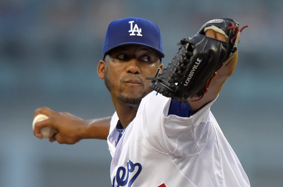 Photo - Los Angeles Dodgers starting pitcher Roberto Hernandez throws to the plate during the first inning of a baseball game against the San Diego Padres, Wednesday, Aug. 20, 2014, in Los Angeles. (AP Photo/Mark J. Terrill)