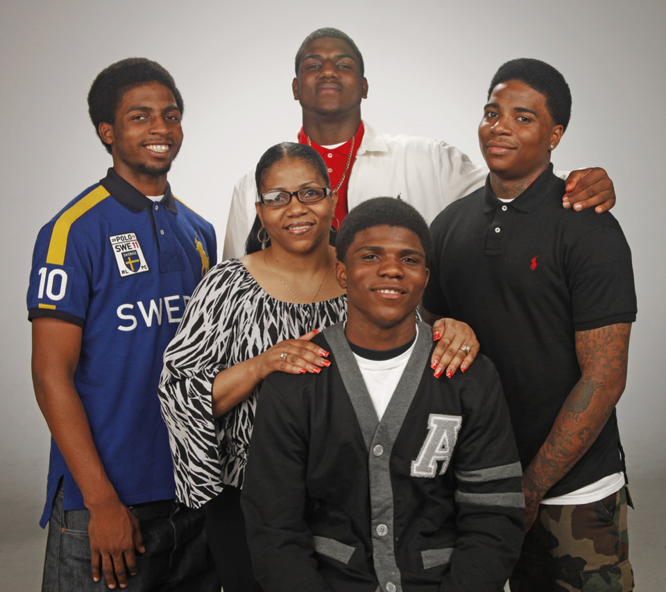 "HIGH SCHOOL BASKETBALL: Douglass High School player Stephen Clark and his family: brothers, from left, D'angelo Clark, Deondre Clark and Dominique Clark and his mother, Dorshell Clark for the Player of the Year ""Family Portrait"" at OPUBCO studio Tuesday, March 27, 2012. Photo by Doug Hoke, The Oklahoman"