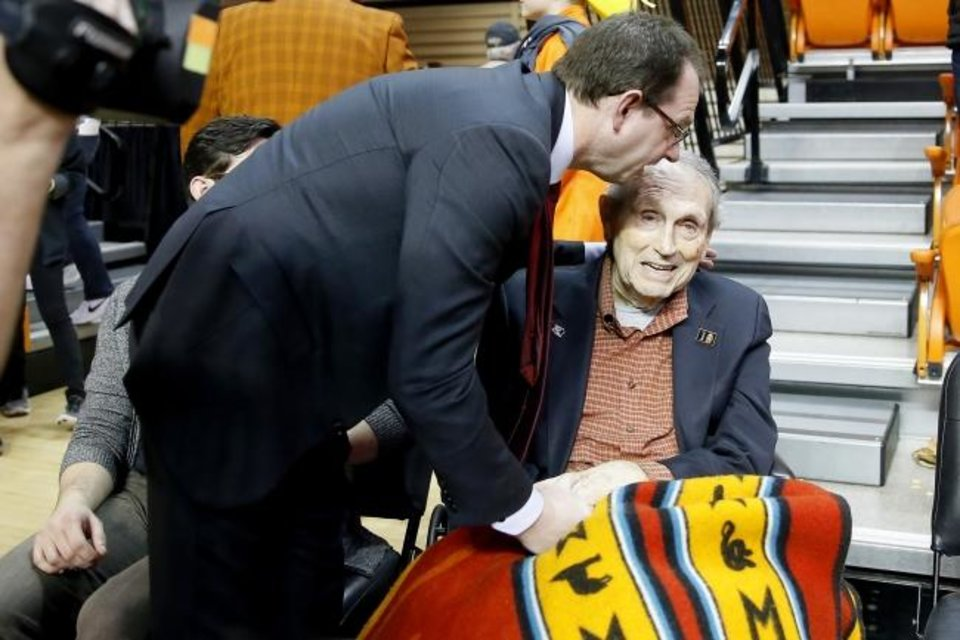 Photo -  Texas Tech assistant Sean Sutton talks with his father, Eddie Sutton, after a 2019 game at Oklahoma State. [Bryan Terry/The Oklahoman]