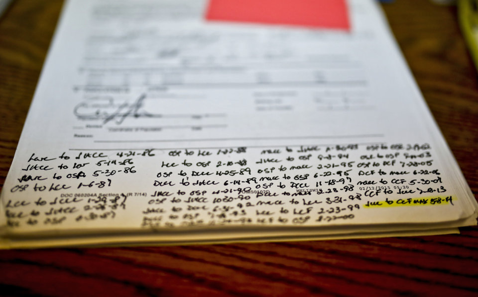 Photo - Paper work shows the hand written log of transfers for an Oklahoma Department of Corrections inmate at the DOC's Lexington Assessment and Reception Center in Lexington, Okla. on Thursday, May 19, 2016.  Photo by Chris Landsberger, The Oklahoman