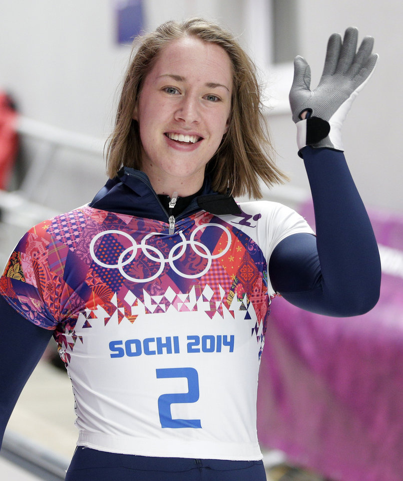 Photo - Elizabeth Yarnold of Great Britain waves to supporters after her third run during the women's skeleton competition at the 2014 Winter Olympics, Friday, Feb. 14, 2014, in Krasnaya Polyana, Russia. (AP Photo/Michael Sohn)