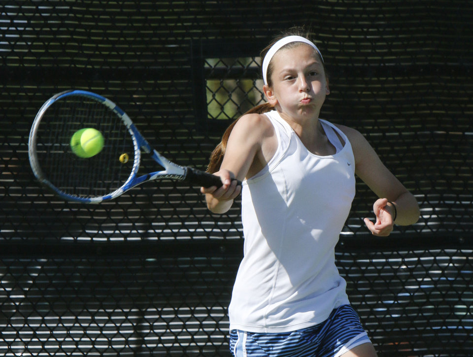 Photo - Bartlesville's Erin Epperson plays against Bishop McGuinness' Katie Conrad in the 6A Girl's state tennis tournament at the OKC Tennis Center in Oklahoma City, OK, Friday, May 9, 2014,  Photo by Paul Hellstern, The Oklahoman