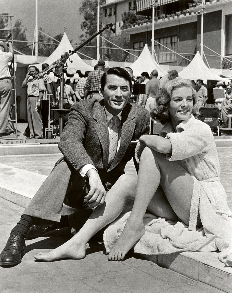 Photo -   In this image released by Beverly Hills Collection, actors Gregory Peck, left, and Lauren Bacall are seen while shooting the film