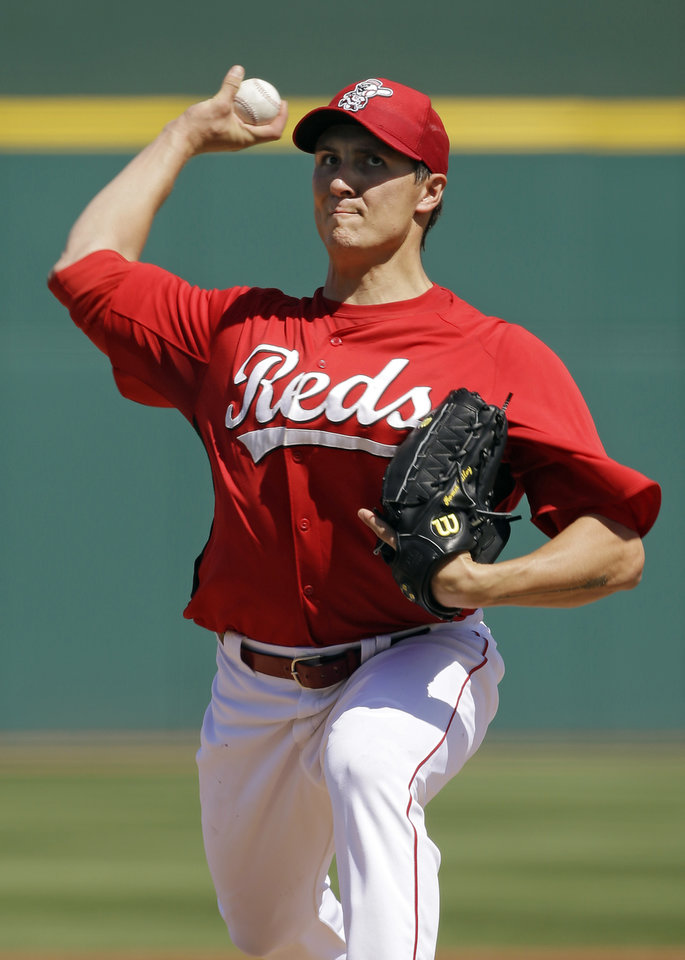 Photo - Cincinnati Reds starting pitcher Homer Bailey throws against the Chicago White Sox in the first inning of a spring training baseball game Tuesday, March 19, 2013, in Goodyear, Ariz. (AP Photo/Mark Duncan)