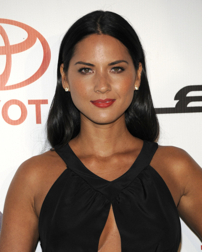 Television personality Olivia Munn arrives at the Environmental Media Awards at Warner Bros. Studios in Burbank, Calif. on Saturday, Oct. 16, 2010. (AP Photo/Dan Steinberg)