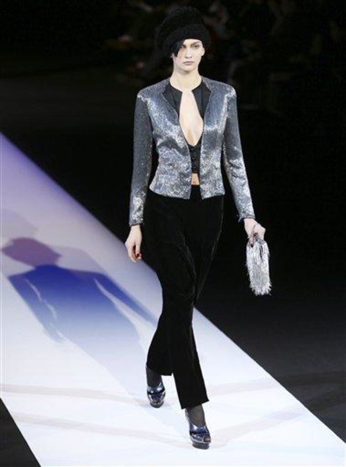 A model wears a creation for Giorgio Armani women\'s Fall-Winter 2013-14 collection, part of the Milan Fashion Week, unveiled in Milan, Italy, Monday, Feb. 25, 2013. (AP Photo/Antonio Calanni)
