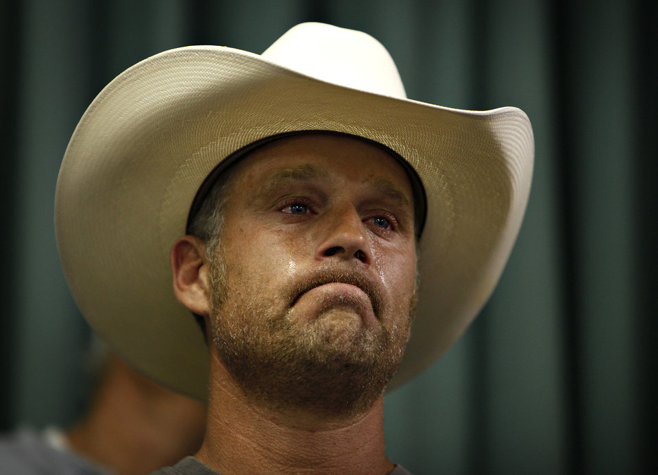 Photo - Tyson Houston, nephew of Cliven Bundy, cries after speaking at a public meeting in the Moapa Valley Community Center in Overton, Nev. Wednesday, April 9, 2014. The meeting was about the roundup by the Bureau of Land Management's roundup of what they call