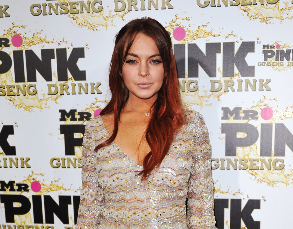 FILE - In this Oct. 11, 2012 file photo, Lindsay Lohan attends the Mr. Pink Ginseng launch party at the Beverly Wilshire hotel in Beverly Hills, Calif. Lohan\'s attorney wrote in a letter filed in court on Feb. 22, 2013, that the actress is willing to record public service announcements and provide inspirational talks at schools and hospitals as a possible way to resolve a case that alleges she lied to police about a car accident. (Photo by Richard Shotwell/Invision/AP, File)