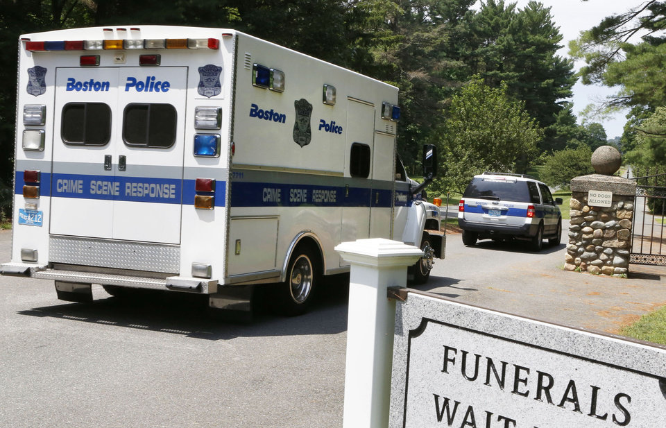 A Boston Police crime scene response van enters the Puritan Lawn Memorial Park Cemetery in Peabody, Mass., where authorities plan to exhume Albert DeSalvo's body from a grave to confirm a forensic link to the Boston Strangler case, Friday, July 12, 2013. DeSalvo was the man who first confessed to being the Boston Strangler, but later recanted before his stabbing death in prison as he served a life sentence for other crimes. (AP Photo/Bizuayehu Tesfaye)