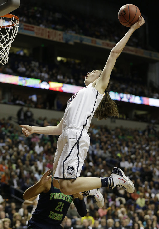 Photo - Connecticut forward Breanna Stewart (30) shoots against Notre Dame guard Kayla McBride (21) during the first half of the championship game in the Final Four of the NCAA women's college basketball tournament, Tuesday, April 8, 2014, in Nashville, Tenn. (AP Photo/Mark Humphrey)