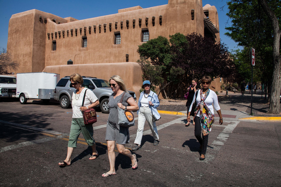 Photo - Clytie Bunyan (right) and a media group that included Anne Cooke, Carolyn Graham, Eleanor Berman and Lena Katz walk through the streets of Santa Fe, N.M., on their way to the farmer's market. Photo by Steve Haggerty/ColorWorld  ©Steve Haggerty