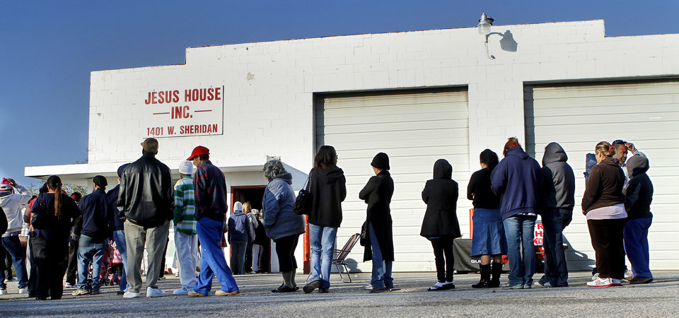 Photo - People line up outside the Jesus House's warehouse to receive free Thanksgiving turkeys and groceries on  Nov. 19, 2012.  Jim Beckel - THE OKLAHOMAN