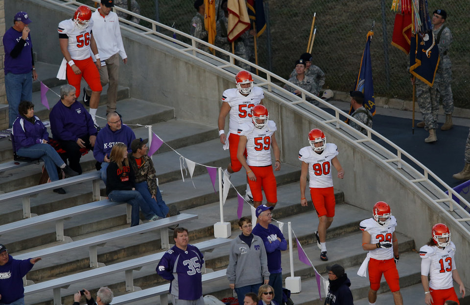 Oklahoma State special teams walks on to the field for warmups during the college football game between Kansas State University (KSU) and Oklahoma State (OSU) at  Bill Snyder Family Football Stadium in Manhattan, Kan.,  Saturday, Nov. 3, 2012. Photo by Sarah Phipps, The Oklahoman