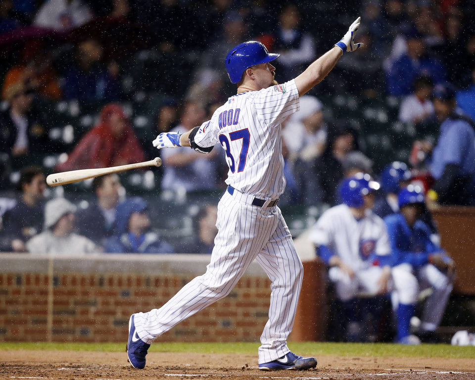Photo - Chicago Cubs' Travis Wood watches his three-run home run against the Arizona Diamondbacks during the second inning of a baseball game on Monday, April 21, 2014, in Chicago. (AP Photo/Andrew A. Nelles)