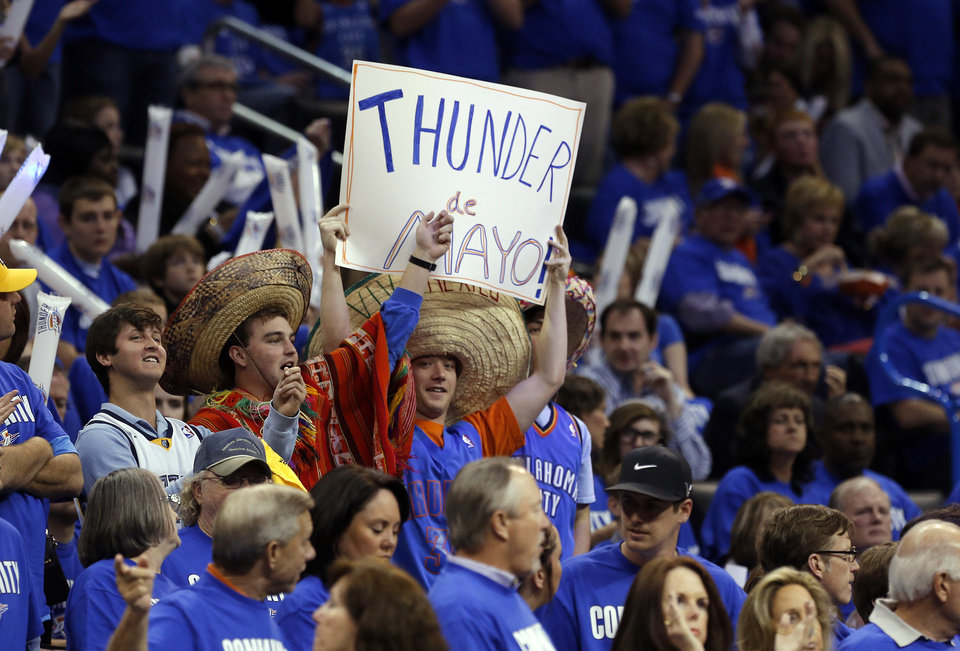 Photo - Fans cheer during Game 1 in the second round of the NBA playoffs between the Oklahoma City Thunder and the Memphis Grizzlies at Chesapeake Energy Arena in Oklahoma City, Sunday, May 5, 2013. Photo by Sarah Phipps, The Oklahoman