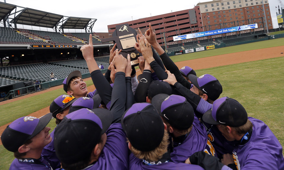 Photo - Red Oak celebrates their win over Asher in the Class B Fall baseball state at the Chickasaw Bricktown Ballpark in Oklahoma City, Saturday, Oct. 6, 2012. Photo by Sarah Phipps, The Oklahoman