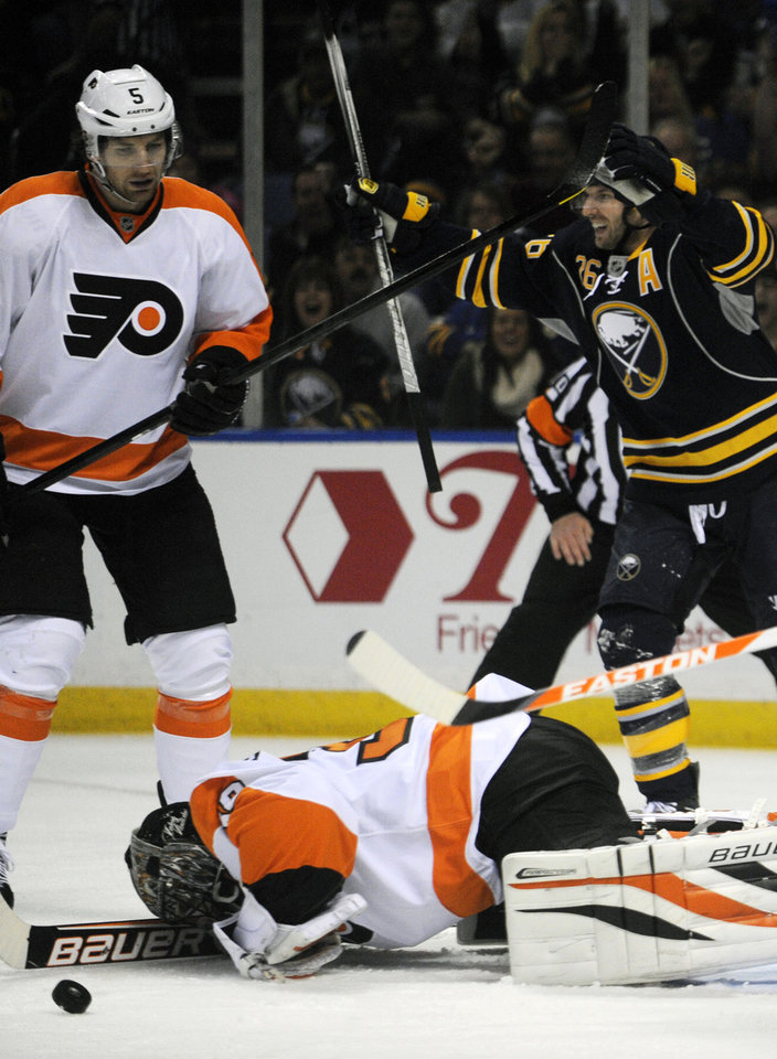 Philadelphia Flyers defenseman Braydon Coburn and goaltender Ilya Bryzgalov, of Russia, react after a goal by  Buffalo Sabres as Sabres Thomas Vanek,right,  of Austria, celebrates during the first period of an NHL season opener hockey game in Buffalo, N.Y., Sunday, Jan. 20, 2013. (AP Photo/Gary Wiepert)